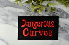 DANGEROUS CURVES Iron on Patch