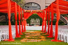 Love the color in the drape treatment over the guests, not just at the mandap