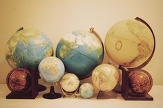 globes - on top of bookshelf, like the look of the collection of them