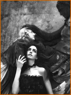 Old statues...black, lace dress...a storm approaching....wish I could enter this scene...