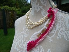 Crocheted feather, you can place it on your hat,  or use it on a necklace. It's a nice item to embellish your bag with.