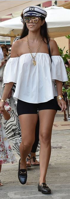 Kourtney Kardashian: Shirt – Vince Watch – Bvlgari Bracelet – Cartier Shoes – Gucci Purse – Dolce & Gabbana Sunglasses – Dior