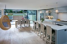 In 'Social Hub', a young couple's shared vision transformed a gloomy basement kitchen into an elegant and sociable indoor-outdoor living space for their growing family