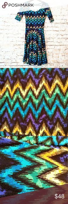 Vibrant Zig Zag Lularoe Nicole XS NWOT Amazing Lularoe Nicole with vibrant zig zag print in black, blue, green, purple, & yellow. Above the elbow sleeves with below the knee length. New without tags! Offers welcome! LuLaRoe Dresses