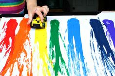 Create a rainbow as you play with cars and ramps in this fun rainbow painting activity for kids. Great for preschoolers.