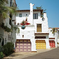 Santa Barbara's Cota Street Studios by Architect Jeff Shelton.  Bold, contrasting lines, textures, patterns, and colors.  I really like the crazy tall chimney that splits in two directions.