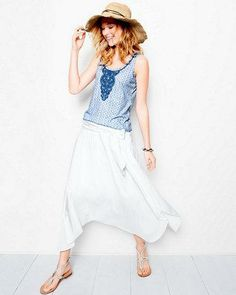 This fun, flirty skirt is as comfy as a knit skirt but with a dressier vibe. Crafted from a luxe and lightweight silk blend, it has two layers that overlap front to back, with high slits on the sides (knee-length lining keeps you from showing too much leg).