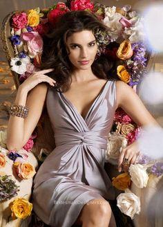Opal taffeta A-line tea-length bridesmaid dress, pleated V-neckline, high-waisted skirt.