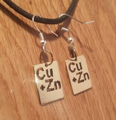 An enigmatic norse symbol found on many viking artifacts many brass periodic table fish hook dangle earrings show off your geek credentials and love of science chemistry urtaz Gallery