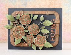 Well...hi everyone! Pam here... I had fun grunging and distressing up the new Steampunk Pipes die! Then it was what to put with it! I have a friend that likes Steampunk, so I decided to distress up the new English Rose Bouquet, Gearworks Border, Uppercase Alphabet Soup letters and add them to the frame I made with the die cut pipes. I die cut everything from white card-stock, inked completely with Rusty Hinge and then Black Soot Distress inks. The Rose Bouquet I die cut from white twice…