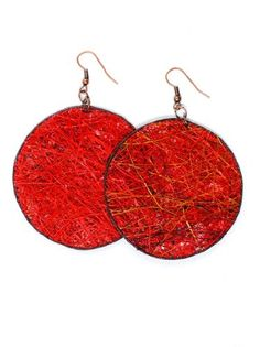 JousJous Red Eco Friendly Fair Trade Handmade Dangling Fique Chip Earrings:    Hand-woven round earrings made from the Fique/Agave plant in Colombia. The pair is one of a kind.