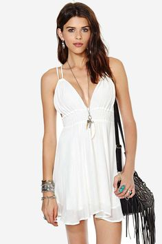 Lighten up this summer in this super fun and airy dress! It has a deep v-neckline, smocked waist,...