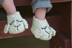 Knit Lamb Shoes pattern by Pamela Wynne. Published in the Juniper Moon Farm website, available as a pdf download on Ravelry. Knit in one piece and seamed together, they have an embroidered lamb face and an extra layer of cushioning for the sole. Sizes: Toddler, Child, Adult Medium, and Adult Large.