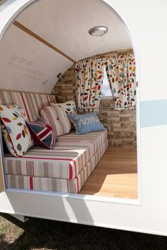 I like the idea of folding the cushions up because it would allow the interior of the cabin to be used as a storage space while traveling.  This is a great idea also for how to fix the floor:  Could use linoleum or could use a small amount of laminate flooring.  Great colors inside too. gepimpte caravan vintage retro trailer diy camper vouwwagen vouwcaravan