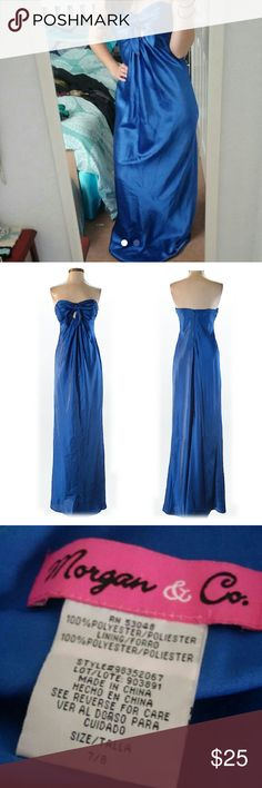 Blue formal gown Beautiful blue elegant formal dress with peek-a-boo cutout on the chest. Size 7/8. Morgan & Co. Dresses Prom