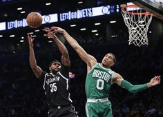 Boston Celtics' Jayson Tatum (0) blocks a shot by Brooklyn Nets' Trevor Booker (35) during the first half of an NBA basketball game Tuesday, Nov. 14, 2017, in New York. (AP Photo/Frank Franklin II)