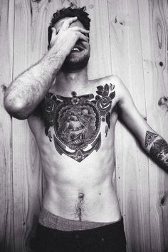 Anchor Ship  & roses on chest tattoo