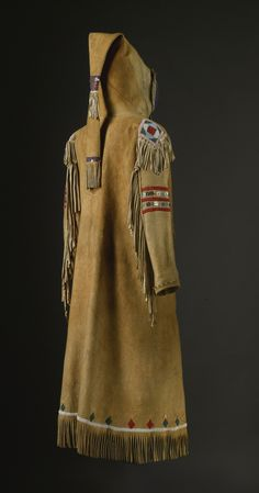 """CREE native American BEADED AND FRINGED HIDE CAPOTE of classic construction, thread sewn with glass beadwork and sequins, with """"epaulettes"""" on the shoulders, and a series of diamond designs along the hemline. length without fringe 45 in. Native American Clothing, Native American Beauty, Native American Artifacts, Native American Beadwork, American Indian Art, Native American History, American Indians, American Apparel, Cree Indians"""