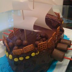 DIY pirate ship cake. The kids made this cake last summer. Though not very professional looking, they had fun making and eating it!