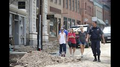 Shop Owners React to Damage Jen Rynda / Baltimore Sun Media Group Shop owners see the flood damage on Main Street in Ellicott City.