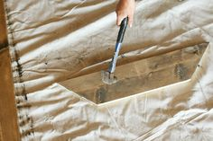 Using a hammer to make new wood look like old, warn and weathered wood.  From The Dempster Logbook.