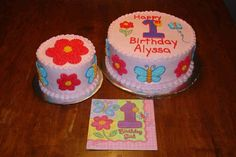 These 1st birthday cakes are iced smooth in pink buttercream.  Buttercream designs on sides and top were done to match the theme.