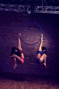 Beautiful for a spinning pose if you have their crazy core strength. Leah Rose Clarke and Sarah Scott