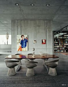 Concrete walls but still warm atmosphere. Warren Platner chairs. Loft in Berlin posters prints paintings graphics