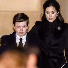 Crown Princess Mary with son Prince Christian as the coffin of Prince Henrik, The Prince Consort, passes at Christianborg. Feb. 16, 2018