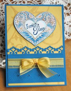 handmade wedding card ... blue and yellow with a bit of white ... perfect bow ... luv the color combo ... bright and beautiful ...