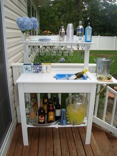 World Market Potting Bench turned bar...just added mirror trim to hang wine glasses and towel bar to side. Made by me : )