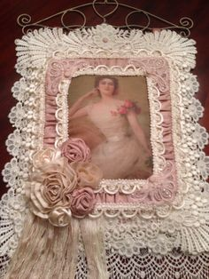 Embellished picture frame or wall hanging.