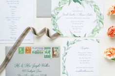 Watercolor greenery and grey wedding invitation is paired with a suite of vintage stamps.