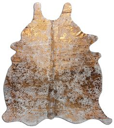 Metallic Cowhide Rug in Gold  www.decohides.com your source for cowhide rugs in USA
