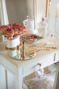 Beautiful and feminine white vanity with pink and gold accents