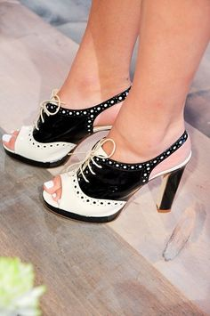 Kate Spade gives us her spin on the black and white oxford, adding a heel and slingback.