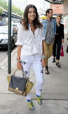 Blogger Leandra Medine, better known as The Man Repeller, matches a pair of Southwestern-inspired denim with a preppy white button-down.