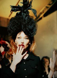 Carla Bruni backstage for CHANEL Runway Show, 1995