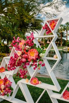 geometric floral backdrop - photo by The Melideos http://ruffledblog.com/bougainvillea-estate-wedding