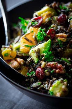 wild rice salad with cranberries, apricots and avocado. A delicious make-ahead side dish for Christmas or other holidays. It is naturally gluten-free and vegan friendly.