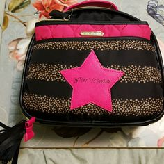 Betsey Johnson Train Case Black with large pink Betsey Johnson Star and gold star stripes.  Zipper Closure. Black tassel with pink bow.  Pink Handle. PLUS. Pink zipper bag with harts embroidered. Betsey Johnson Bags Travel Bags