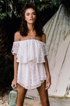 The Bold Polka Frill Playsuit is made from a sheer off white overlay with textured polka dots throughout. It is an off shoulder style and features a frill overlay across shoulders, an elasticated waistband and blush drawstrings at waist and shoulders. Complete the look with neutral heels and a clutch to match for your next night out! By SABO LUXE.