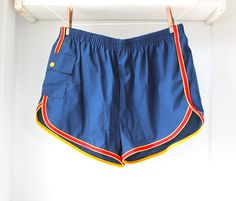 1970s royal blue workout shorts with red trim and side pocket