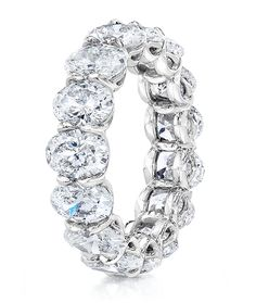Cellini Jewelers Cellini Oval-Cut Diamond Eternity Band  Oval-cut diamonds, in a handmade, shared-prong, platinum setting.  Total diamond weight shown is 7.81 carats.
