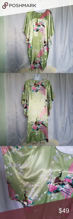 """GREEN KIMONO WITH PEACOCK & FLOWER PRINT LIGHT GREEN KIMONO WITH PEACOCK AND FLOWERS PRINT. This beautiful and elegant kimono by Tian Bao Gong. I believe this was pirchased in China while traveling. NWT  It has a satiny look and feel. Gorgeous and comfortable. Armpit to armpit is 28"""" and shoulder to hem length is 40"""" side splits open up 7.25"""" from hem. All measurements are approximate and taken flat. Turquoise,pink,purple,white and gray accent the light green perfectly. Dresses Midi"""