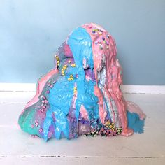 blob - arianne wilson the exorcism of barbie   aprox. height - 24 inches, diameter - 90 inches  (resin, paper flowers, glitter, cake decorations, expanding foam, plaster, sweets, spray paint)