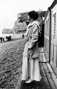 GABRIELLE 'COCO' CHANEL (1883-1971), photographed on the beach in Etretat, Normandy, early 20th century.