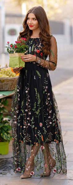 Serve up goth fairy princess vibes with this black mesh maxi dress boasting colorful florals all over it.  Lost in Flowering Fields Embroidered Mesh Maxi Dress featured by Larisa Costea Blog