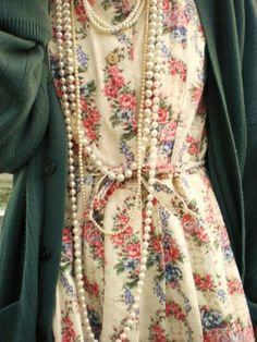 Floral dress and strings of pearls