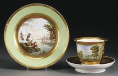 BERLIN TOPOGRAPHICAL PORCELAIN CUP AND SAUCER, CIRCA 1800